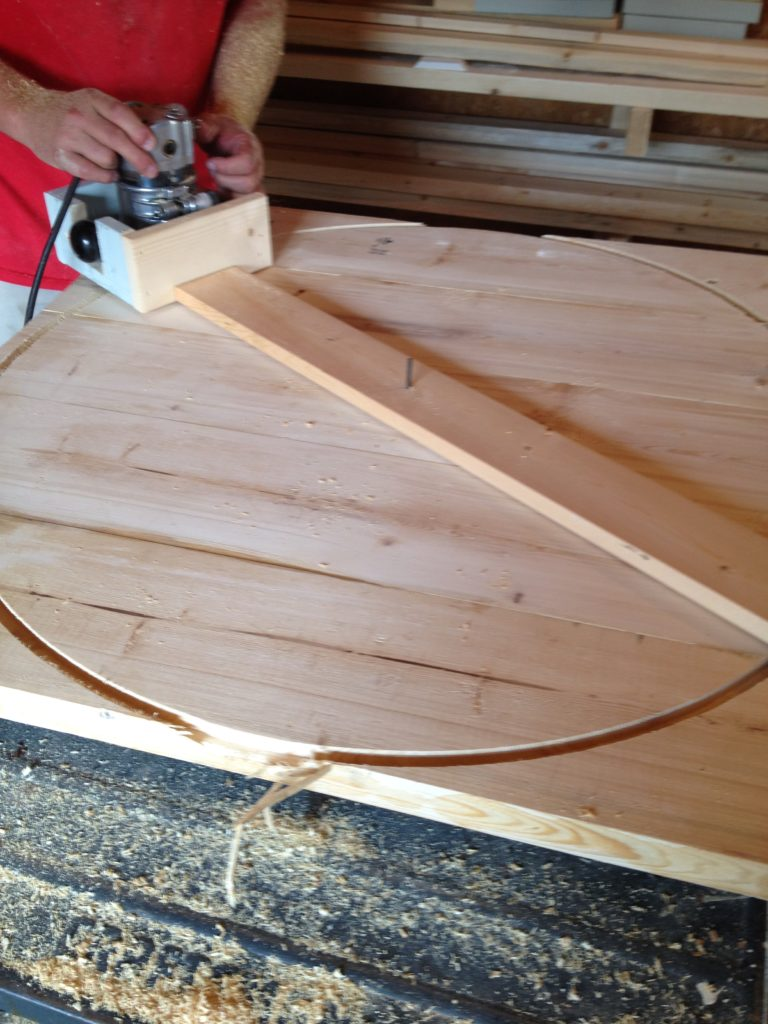 Using router and circle jig to cut round table top from glued up panel
