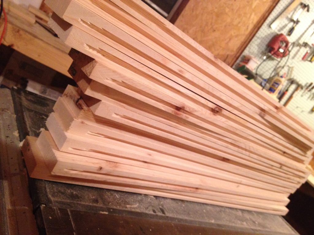"""Stack of cabinet door frame pieces with ¼"""" dadoes cut for panels"""