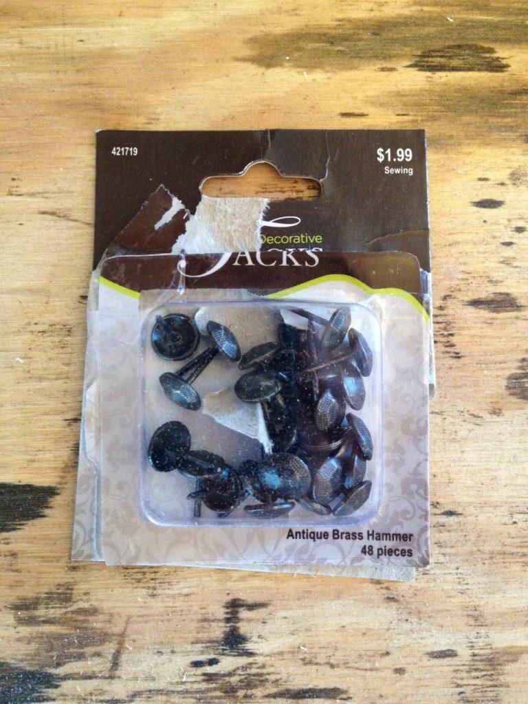 Upholstry tacks in package