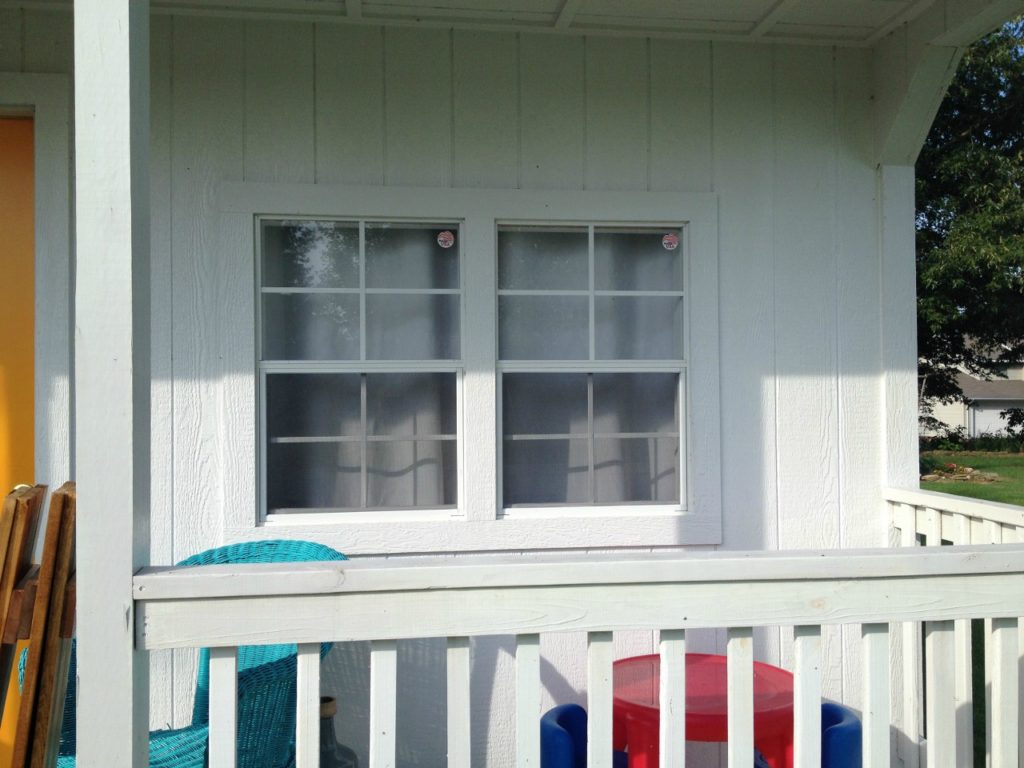 She shed without shutters on front window