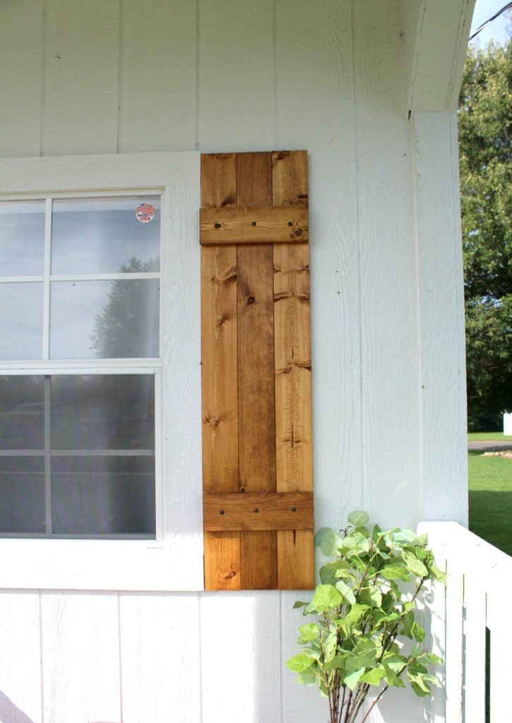Close up of right side window shutter made from wooden 1x4 boards