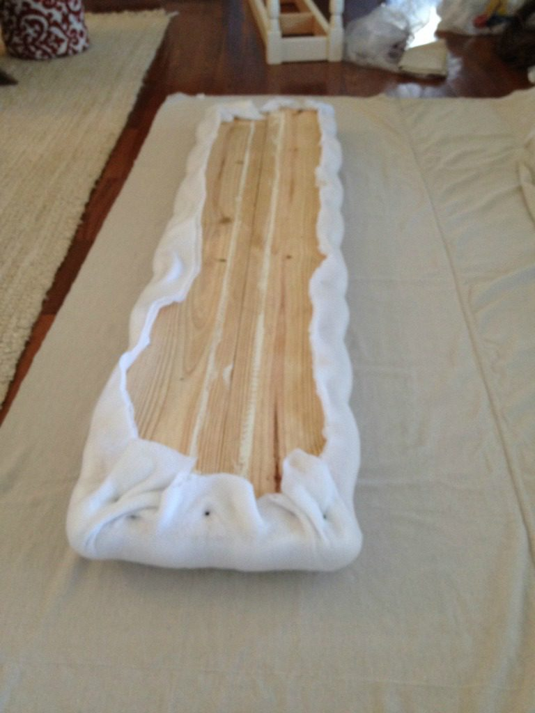 Lay out fabric to wrap around wooden bench seat