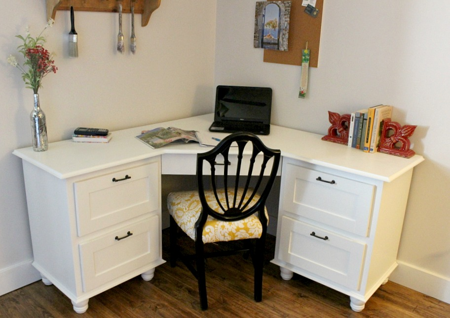 White painted DIY corner desk with trim molding and furniture feet--professional looking corner desk