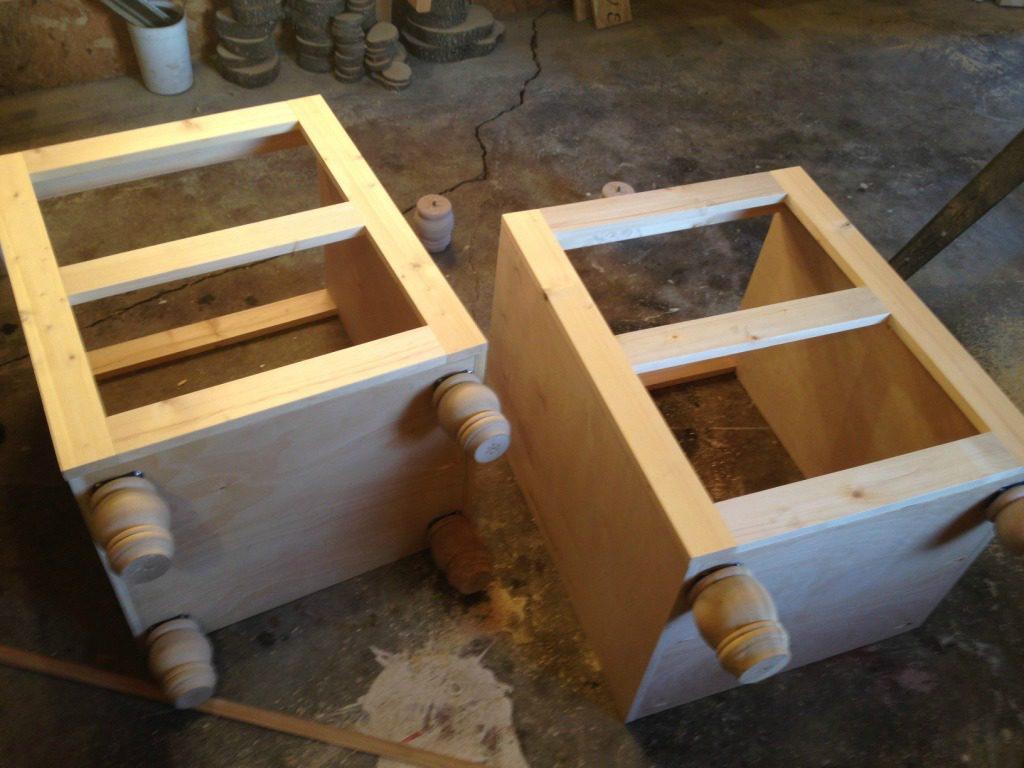 Corner desk side cabinets assembled with face frames attached on front