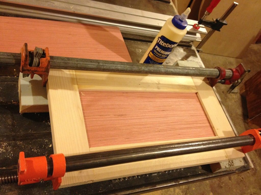 Shaker style drawer front in clamps while glue dries