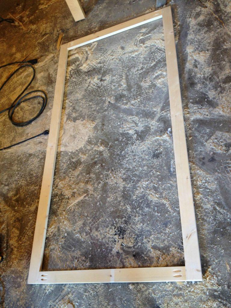 Bookshelf face frame assembled on workshop floor using pocket holes