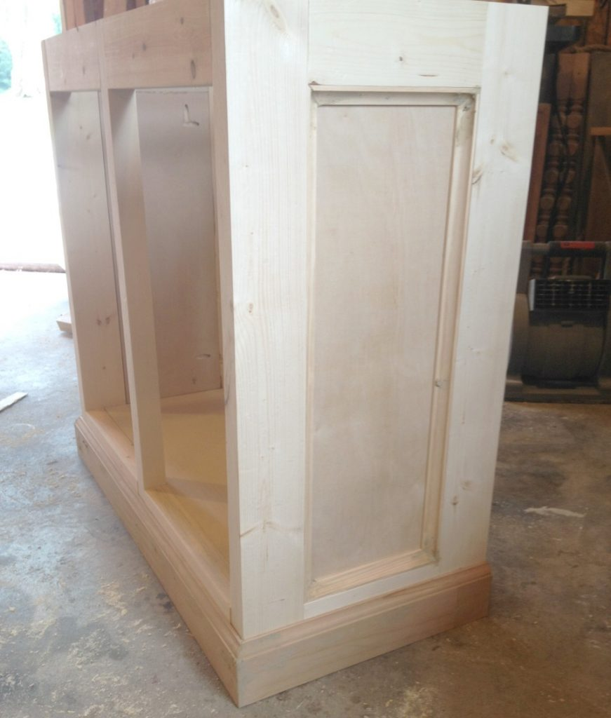 Cove molding added to side panels and baseboard added to bottom of aquarium stand