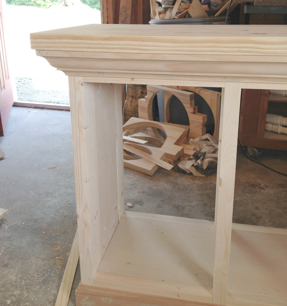 Crown molding added around top of aquarium cabinet stand