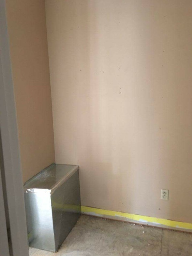 DIY Mudroom Transformation Left side Before with Large Air Duct in corner