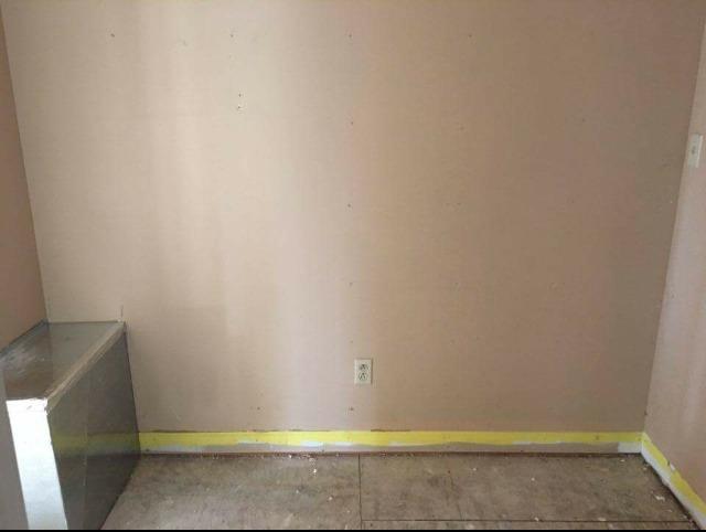 DIY Mudroom Built Ins--The blank slate before
