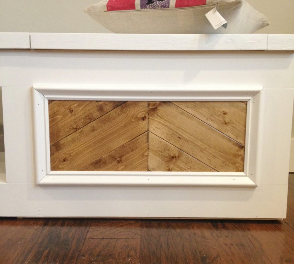 Base cap molding added to front panels of built in shoe bench