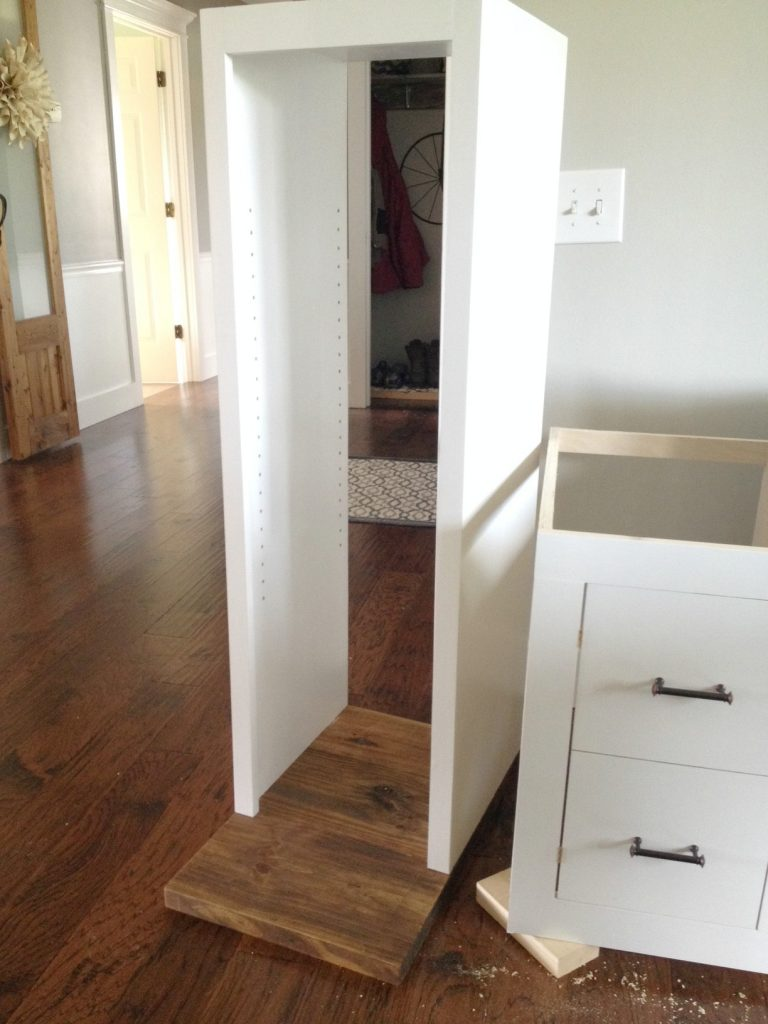 Open shelving cabinet carcass attached to countertop