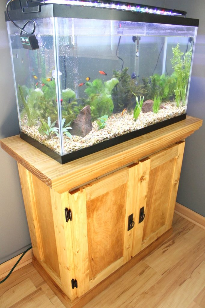 DIY aquarium cabinet stand finished in Golden Oak Wood stain