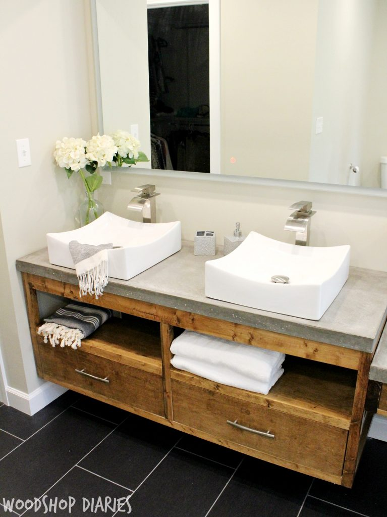 Modern Bathroom with concrete counter tops, vessel sinks, and silver finishes. Gorgeous modern style bathroom