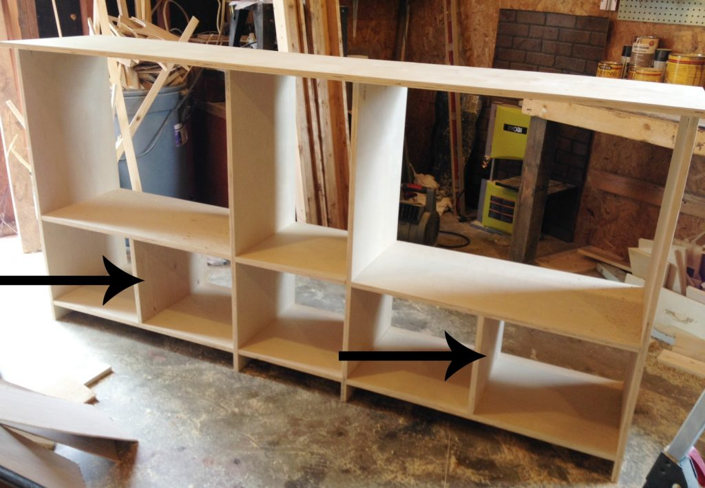 Adding cubby dividers to bottom of storage console