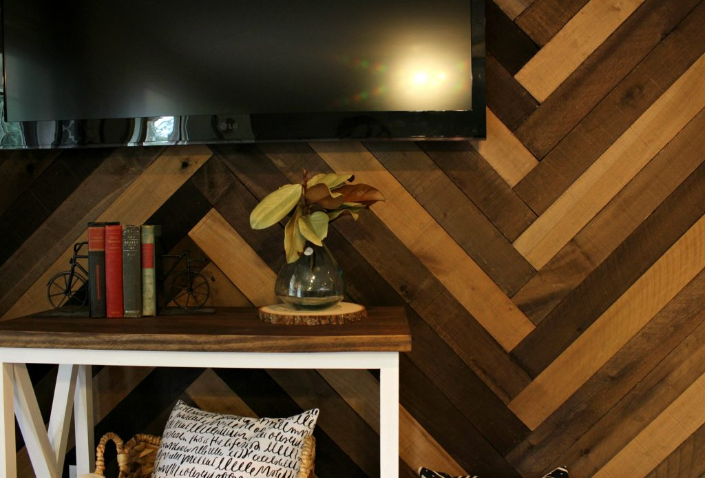 DIY Herringbone Barn Wood Wall--give your wall a rustic feel with these weathered wall boards