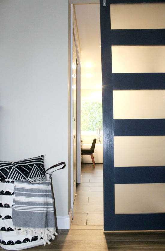 Modern Navy Sliding Door for bathroom--learn how to make your own!