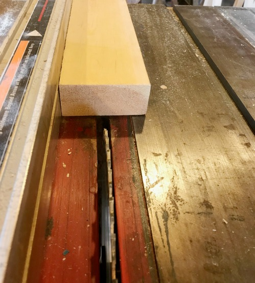 """2x4 board on table saw with square edge against rip fence set to cut 1 ½"""""""