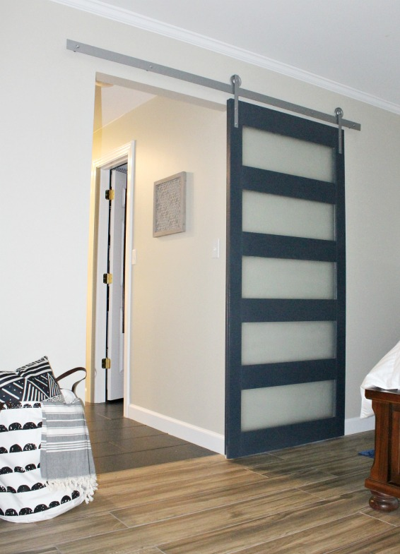DIY Modern Sliding Door with DIY hardware instructions too! Glass panels make this mid century modern design unique