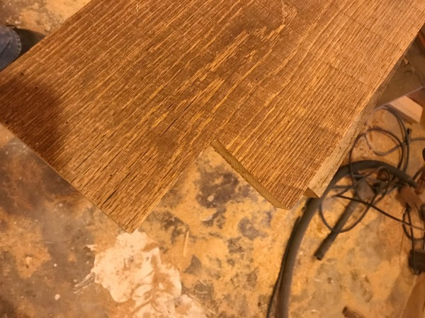 cut notches in barn wood top for table legs