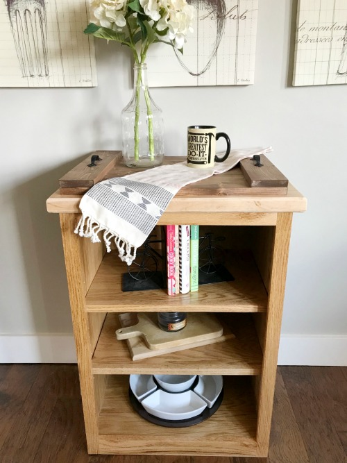 Simple DIY shelf with cookbooks and cutting boards