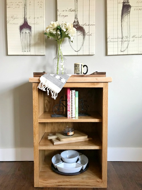 Simple little DIY stand alone bookshelf in kitchen with cookbooks