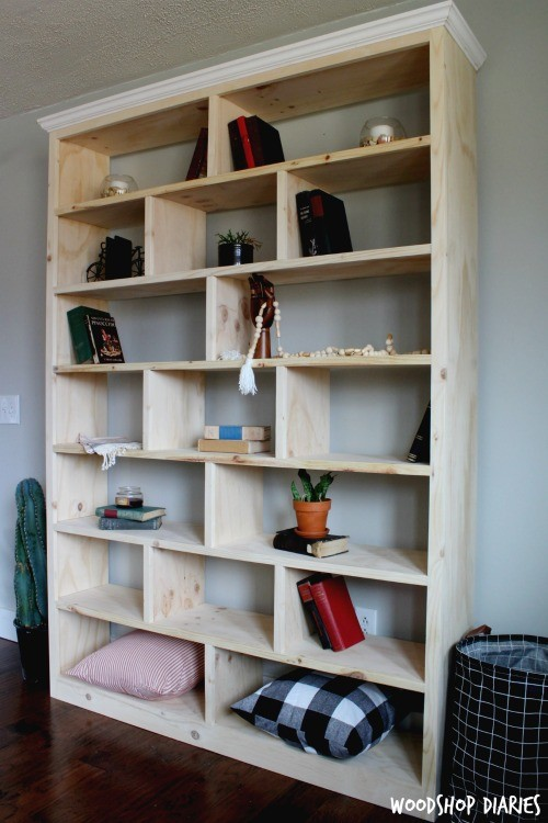 Unfinished pine plywood DIY bookshelf with crown molding
