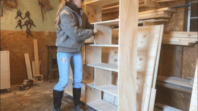 Installing bookshelf divider panels into modern DIY bookshelf