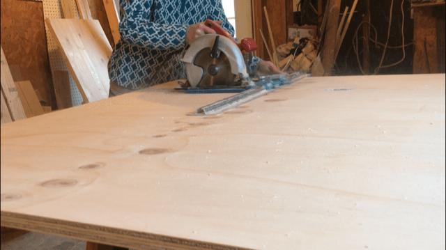 Rip plywood to size to build DIY bookshelf