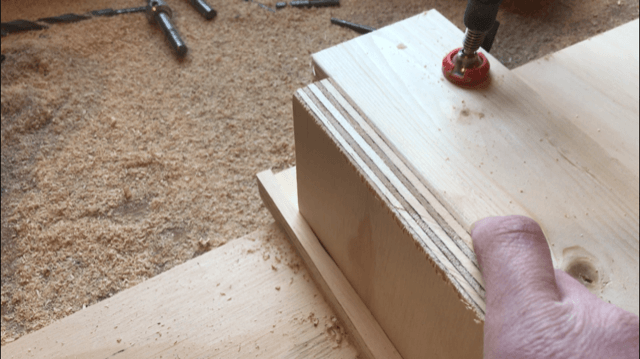 Test fit plywood pieces into dadoes for bookshelf assembly