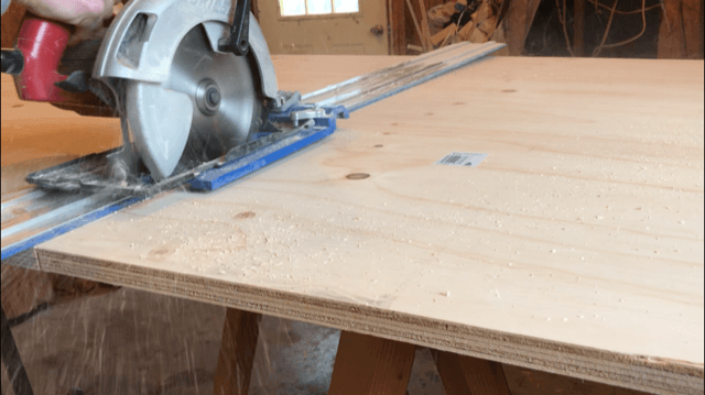 Cut plywood in half to build DIY bookshelf