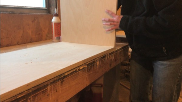 Fold up sides of DIY storage trunk to glue and nail joints together