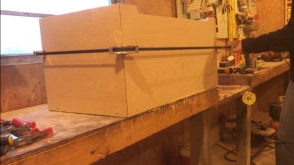 Band clamp to tighten corners of storage box