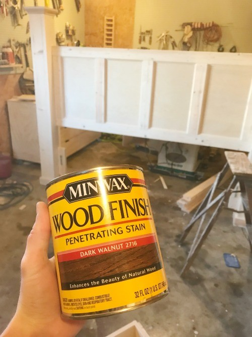 Can of Minwax Dark Walnut Wood Stain Dark Walnut in front of headboard in workshop about to be stained