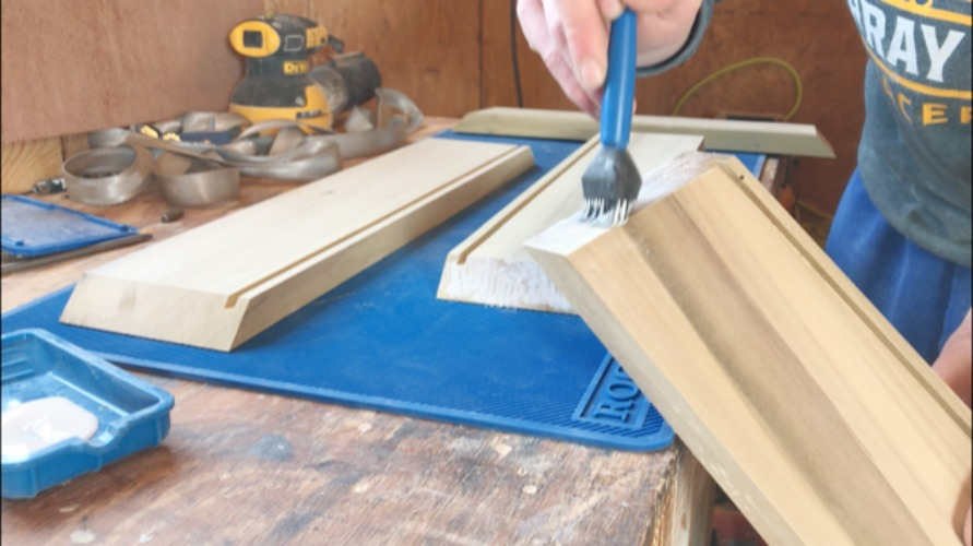 applying glue to mitered keepsake box corners