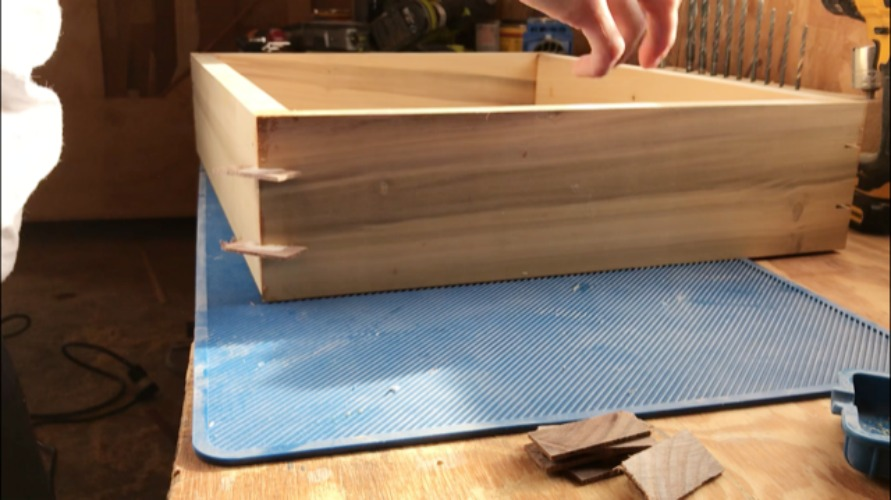 Splines glued into corners of picture frame keepsake box