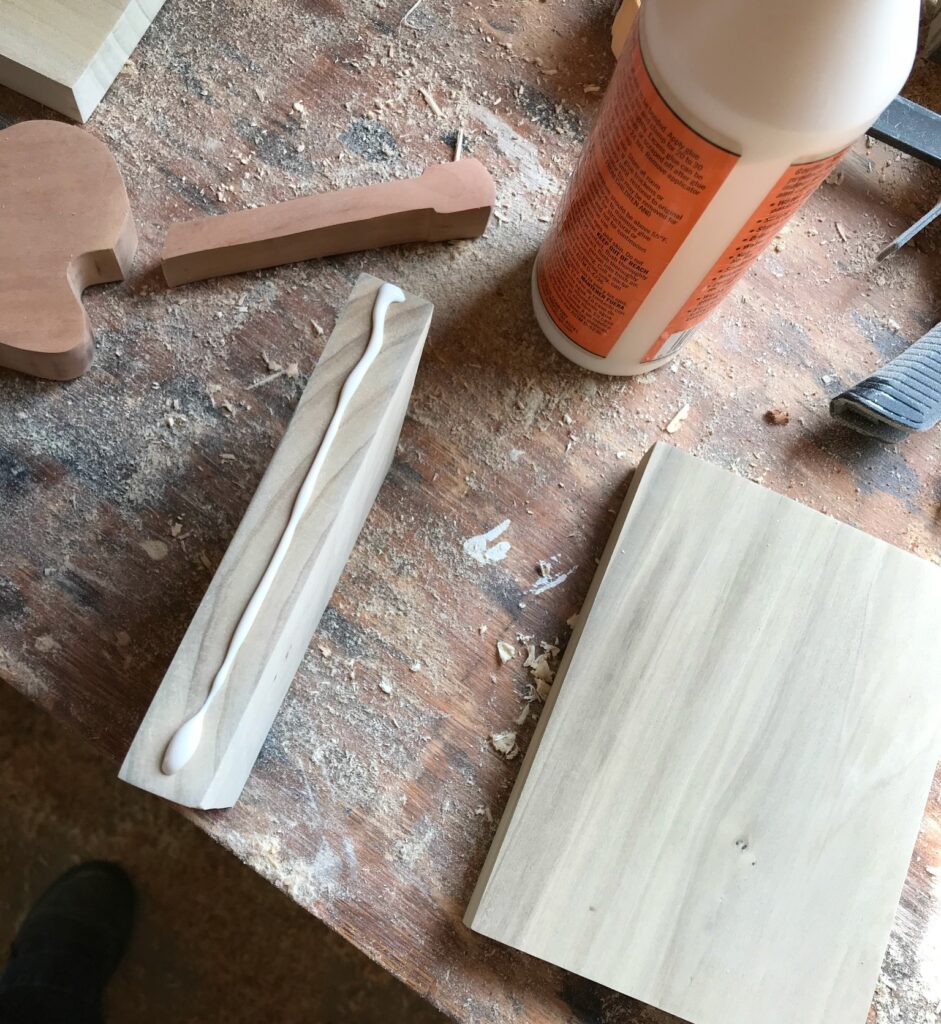 Apply glue to attach book end pieces