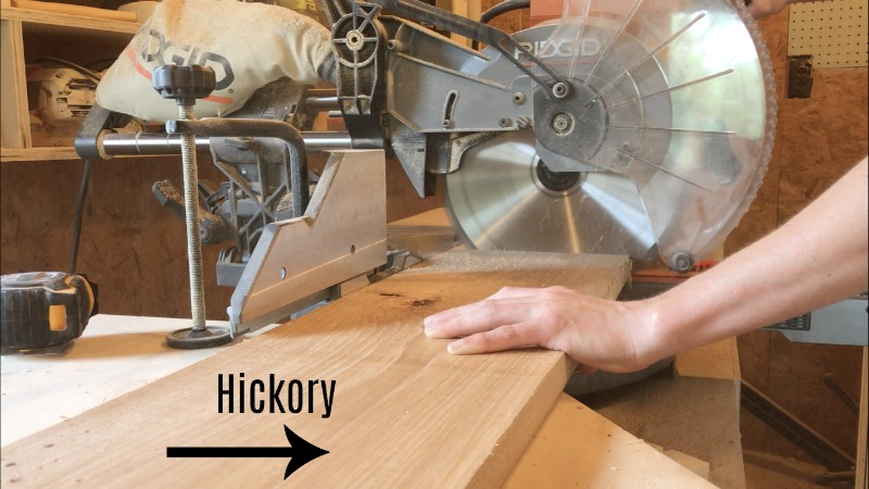 trimming hickory wood to length on miter saw