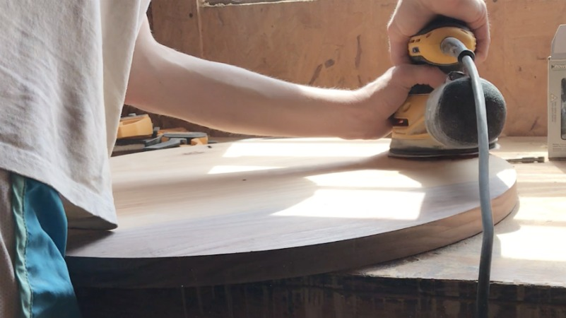 Shara Woodshop Diaries sanding round wood plate to use as a clock