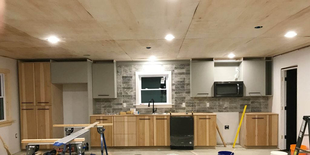 Plywood on ceiling before trim installed on seams