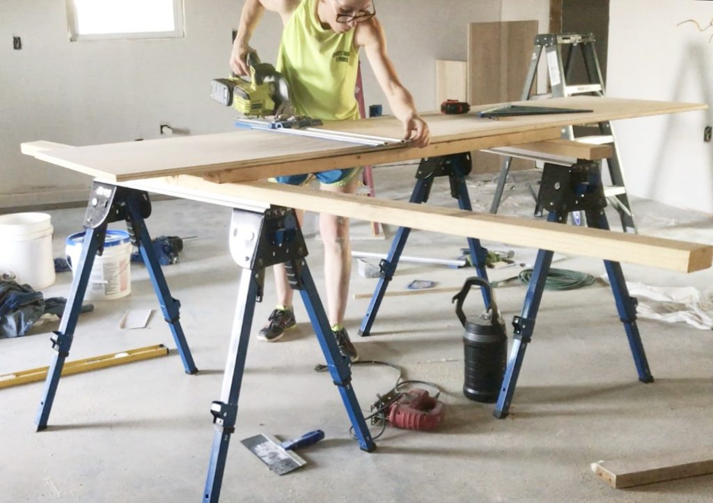 Shara Woodshop Diaries  cutting down plywood using Kreg AccuCut on saw horses