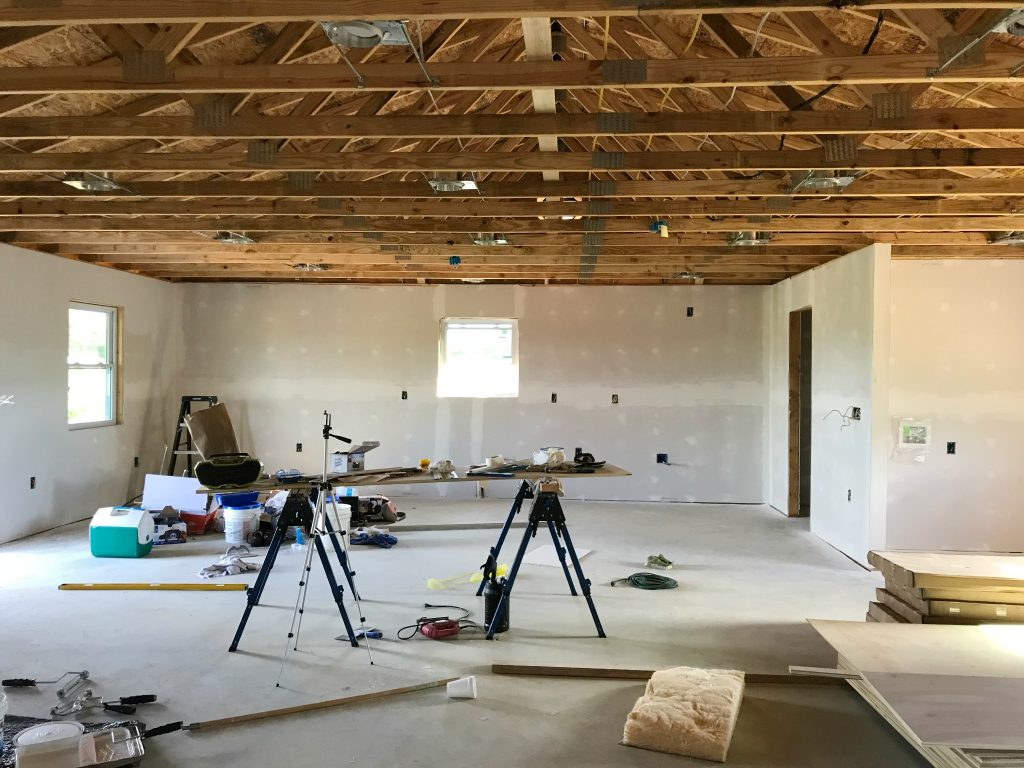 one room garage apartment drywall on walls and trusses open on ceiling