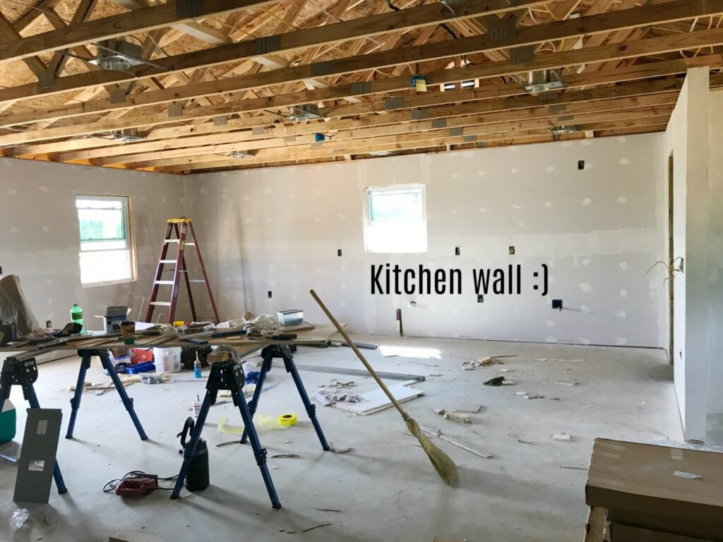 Kitchen wall of unfinished garage apartment