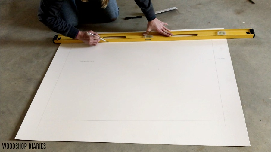 Marking and cutting large mat board using exacto knife and level