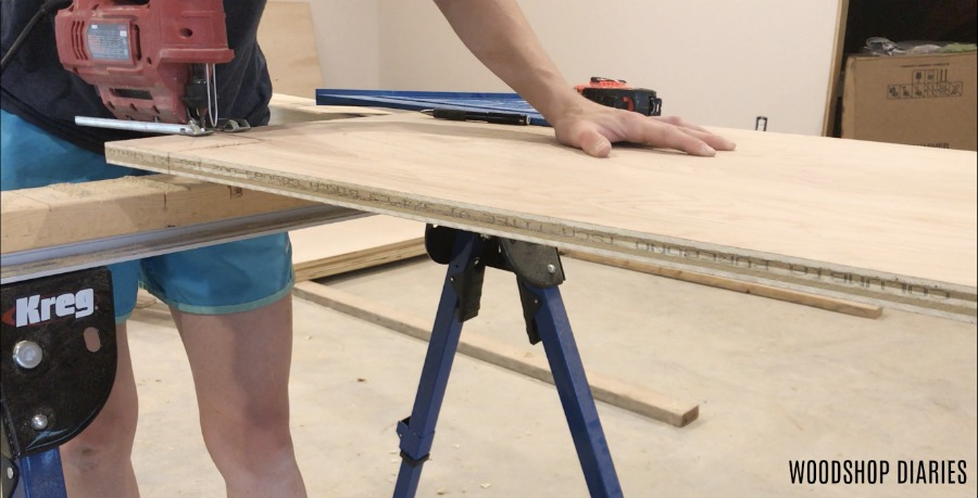 Shara cutting out cabinet toe kicks with jig saw