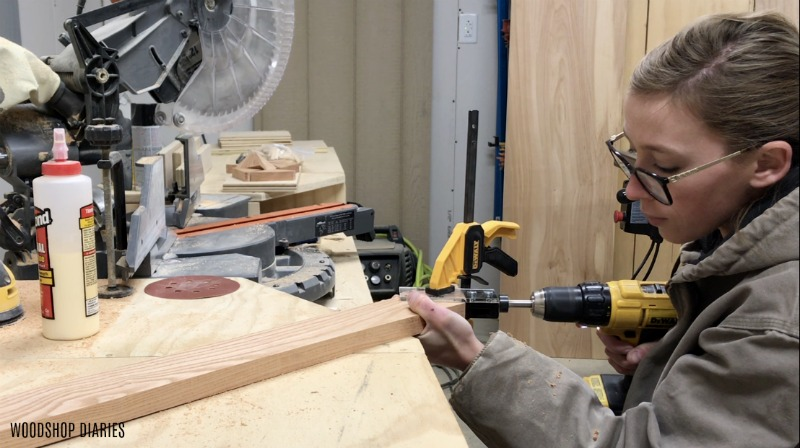 Shara Woodshop Diaries drilling dowel holes into mitered corners to assemble