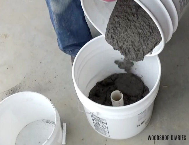Pour concrete into concrete planter mold bucket