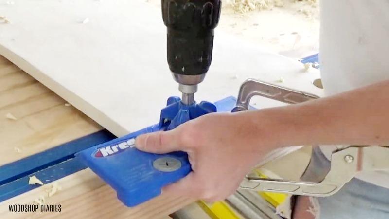 Using Kreg concealed hinge jig to drill concealed hinge cup holes into tilt out hamper doors