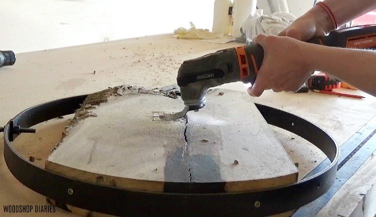 Oscillating saw used to cut out back of clock