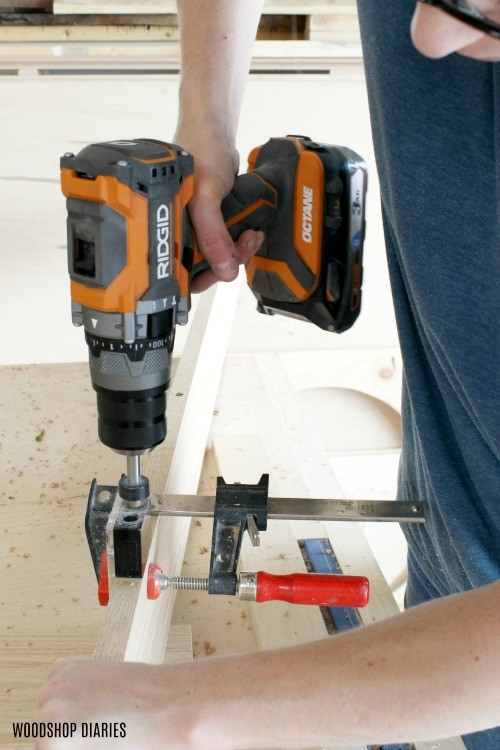 Using hammer drill to drill dowel holes in project